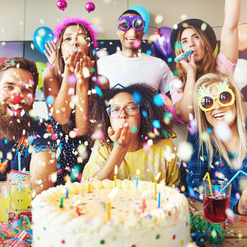 confetti-flying-around-group-celebrating-a-party.jpg
